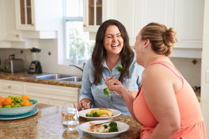 http://www.dreamstime.com/stock-photography-two-overweight-women-diet-eating-healthy-meal-kitchen-image47131532